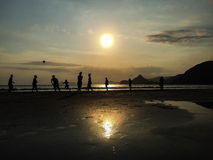 Sunset footbal. A group of young man playing football in the beach. captured from Selong Belanak Beach, Lombok Island, Indonesia Stock Image