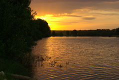 Sunset on forest lake Royalty Free Stock Photo