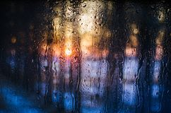 Sunset in the forest through the misted glass Stock Image