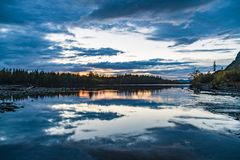 Sunset in the forest. Forest by the river. Russia stock photo
