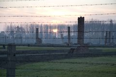 Sunset in the former death camp, Auschwitz-Birkenau Royalty Free Stock Images
