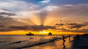 Sunset on Fort Myers Beach. The beautiful sun setting on the shores of Fort Myers Beach located on Estero Island in Florida, United States of America Stock Images