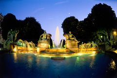 Sunset fountain in Turin Italy. Lighted fountain at dusk in Turin, Italy Royalty Free Stock Image