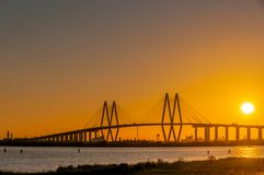 SUNSET AT THE Fred Hartman Bridge royalty free stock photography