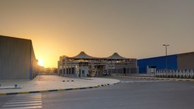 Sunset at free zone of Ajman timelapse. Ajman is the capital of the emirate of Ajman in the United Arab Emirates. Sunset at free zone of Ajman timelapse.. Ajman stock photography