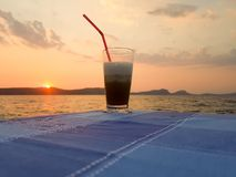 Sunset and a frozen coffee. A calm moment.  stock photo
