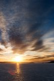 Sunset on Frozen Lake Stock Photo
