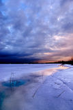 Sunset by a frozen lake Stock Photography