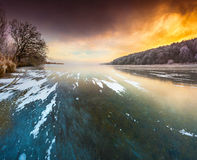 Sunset on frozen lake. Stock Images