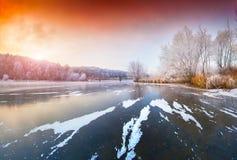 Sunset on frozen lake. Stock Photo
