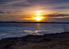 Sunset. On a frozen lake Stock Photos