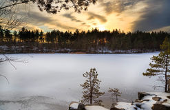 Sunset at the frozen lake Stock Images