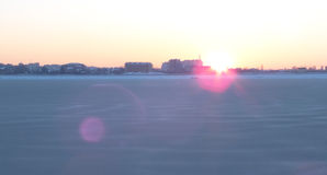 Sunset on a frozen lake Royalty Free Stock Photography
