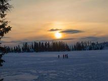 Sunset on frozen lake Royalty Free Stock Images