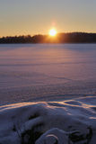 Sunset on frozen lake Stock Image