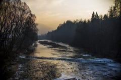 Sunset at a frozen river Stock Photos
