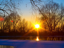 Sunset on the frozen river Stock Photo