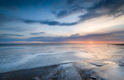Sunset at frozen sea Royalty Free Stock Photo