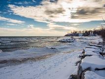 Sunset Frozen Winter Snow Lake Ontario. Frozen Winter Snow icy lake Ontario ice and snow winter lake at sunset Stock Photo