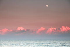 Sunset with full moon Royalty Free Stock Photography