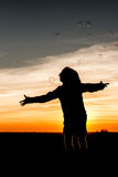 Sunset Child Silhouette. A silhouette of a child having fun with soap bubbles in the sunset Royalty Free Stock Photos