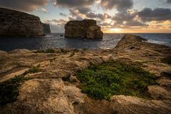 Fungus Rock in the Dwejra Bay, Malta Gozo. Sunset on Fungus Rock on Malta Gozo. Dwejra Bay at the west coast of the Maltese Island of Gozo Stock Photo