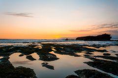 Sunset from Gadon beach with the rock formation near Tanah Lot Temple Royalty Free Stock Photography