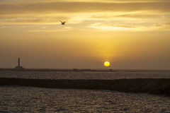 Sunset at Gallipoli with the view of the lighthouse. Italy Stock Photos