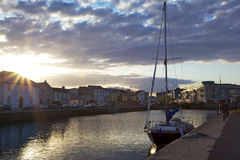 Sunset in Galway - Boat. Sunset in the port of Galsway, Ireland stock images