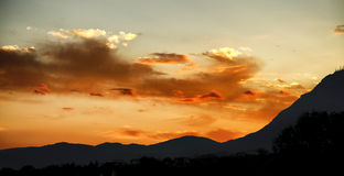 Sunset. Games of clouds at sunset Royalty Free Stock Photo
