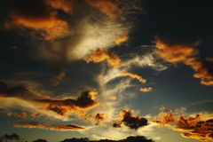Sunset. Games of clouds at sunset Royalty Free Stock Photos
