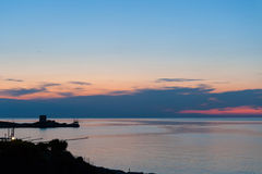 Sunset on the Gargano, trebuchet and Saracen tower royalty free stock photography