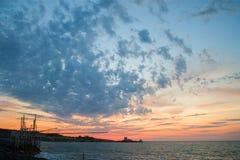 Sunset on the Gargano, trebuchet and Saracen tower stock image