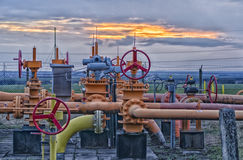 Sunset in the gasfield. Valve in the gas field Stock Image