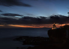 Sunset gazebo on a cliff overlooking the ocean Stock Images