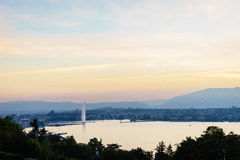 Sunset in Geneva. Aerial view of Geneva from the Collonge-Bellerive over the citys waterfronts on both sides of Rhone river as it flows out of Lake Geneva stock image