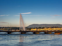 Sunset in Geneva with view of the water jet Stock Image