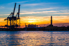Sunset at Genoa`s port, silhouette of the Lanterna, Italy Stock Photo