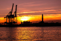 Sunset at Genoa`s port, silhouette of the Lanterna, Italy Stock Photography