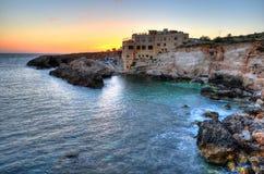 Sunset at Ghar Lapsi – Malta. Beautiful colours at sunset in Ghar Lapsi, the southern coast of Malta Stock Photos