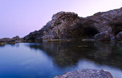 Sunset at Ghar Lapsi - Malta. Sunset over the Cave in Ghar Lapsi in Malta Stock Image