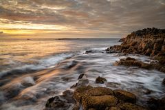 Giant`s Causeway. Sunset at Giant`s Causeway co. Antrim, Northern Ireland stock images