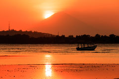 Sunset from Gili Air looking towards the rest of the Gili Island Royalty Free Stock Photo