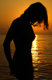Sunset girl. Silhouette of a girl in the sunset Royalty Free Stock Photos