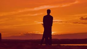 At sunset girl and boy holding hands circling slow motion video stock video footage