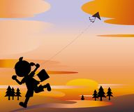 Sunset Girl flying a kite Stock Image