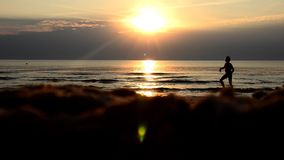Sunset. Girl playing on the beach. stock footage
