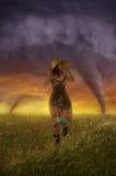 Girl runs away. At sunset, the girl runs away from a tornado royalty free stock photos