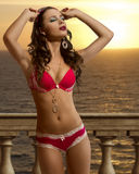 Sunset girl with sexy bikini Royalty Free Stock Image