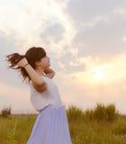 Sunset, girl, wilderness Stock Photography
